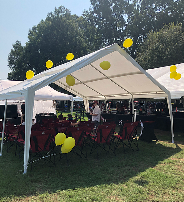 sober tailgate tent with yellow balloons